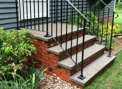 This time with antique brick veneer and black powder coated steel railings. Also available with red brick and never rust aluminum rails. Available width from 4 ft to 8 ft. With the look of individual granite treds , is solidly cast in one piece durability.