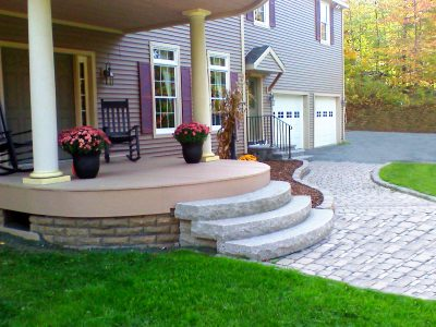 Customized! Made to fit this home owners very unique rounded front porch. The unique radius feature of Rockaround compliments the soft curves of the existing landscaping.